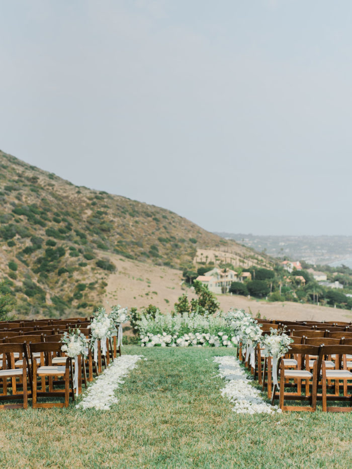 Private estate wedding Malibu ceremony greenery floral backdrop malibu rocky oaks wedding butterfly floral and event design