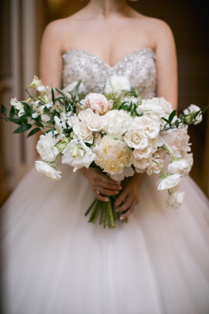Asymmetrical bridal bouquet with greenery