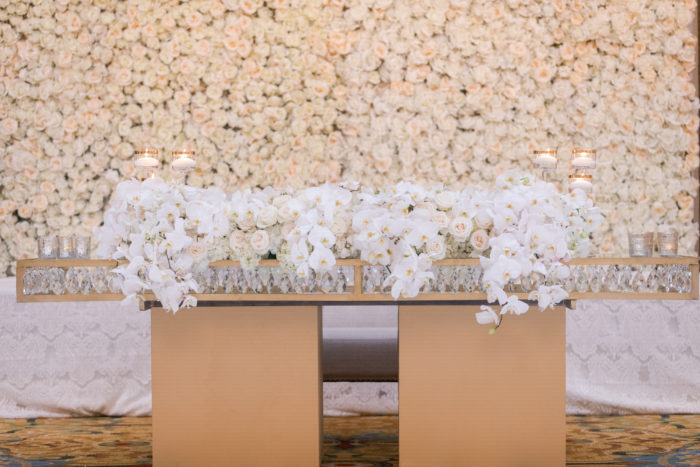 Sweetheart table with gold table and white orchids