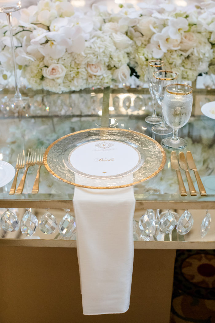 Wedding Place Setting with Gold Rimmed Charger and Clear Table