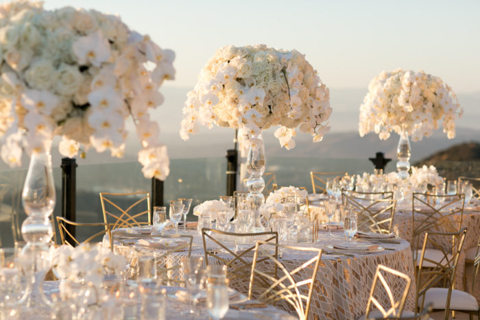 Gold chameleon chairs gold linens white tall centerpieces wedding design