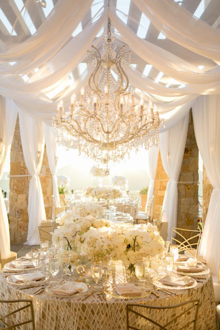Chandelier malibu rocky oaks ivory wedding round tables drapery