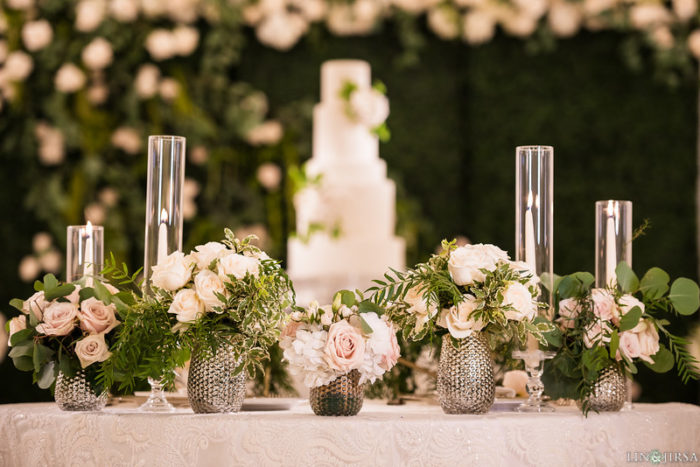 cocktail floral arrangements silver vases hobnail greenery roses taper candles best wedding decor florals butterfly floral