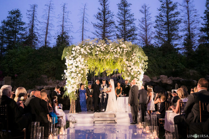 Wedding ceremony four seasons westlake village waterfall lawn chuppah catwalk jewish wedding butterfly floral