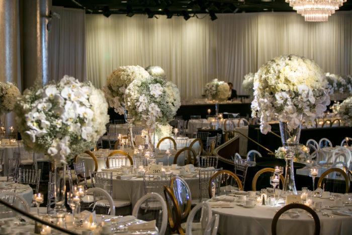 Wedding Reception with White florals in Hotel Ballroom