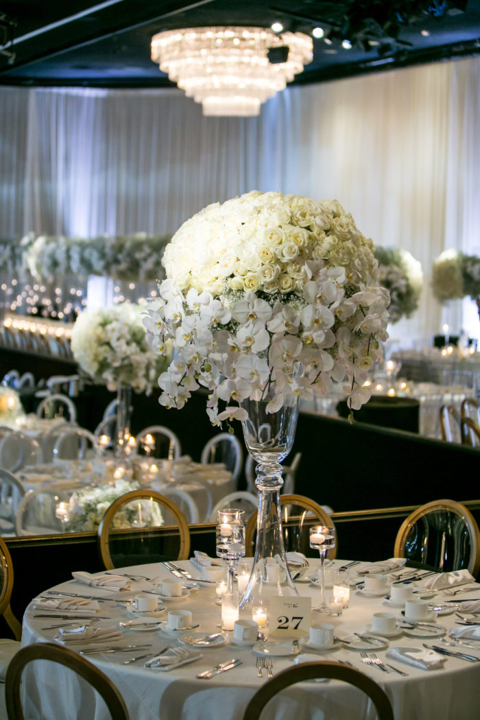 tall wedding floral arrangement with white flowers