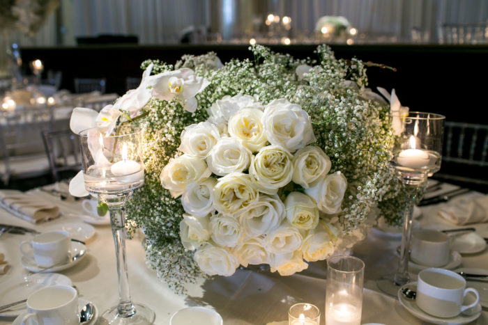 Small wedding floral arrangement with Roses, Orchids, and Babys Breath