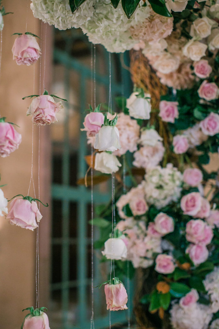 Hanging pink Roses from Wedding Chuppah