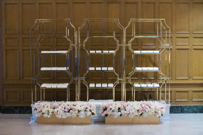 Modern Wedding Escort Card Table on Gold Shelves