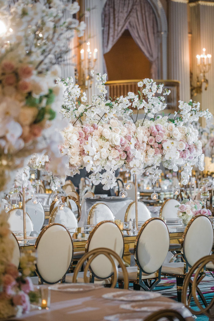 Tall Wedding Centerpieces with Branches and Pink and Ivory Flowers