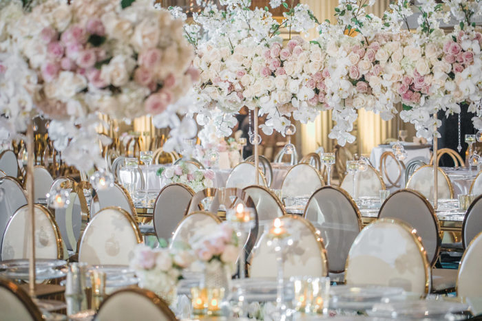 White and Gold Wedding Chairs with Pink Floral Decor