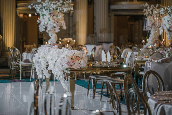 Gold Mirror Sweetheart table with White Orchids
