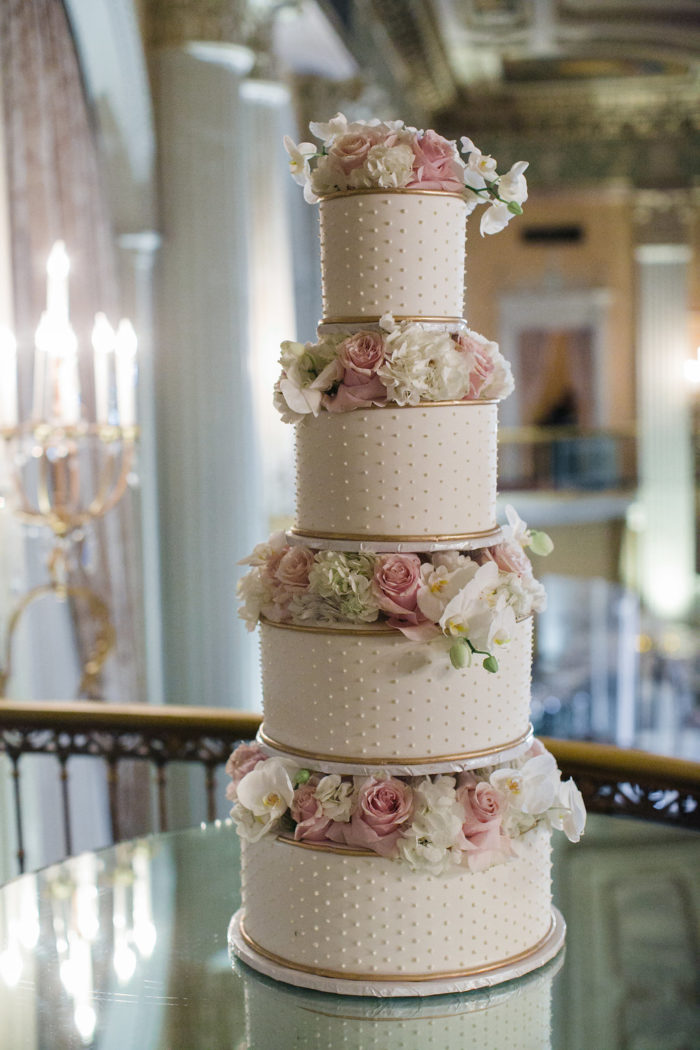 PinDot wedding cake with gold and ivory flowers