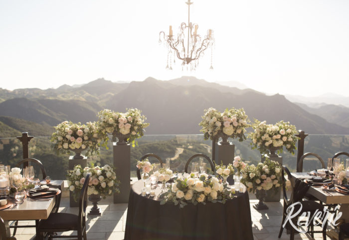 Wood Pillars with Floral Arrangements with Sweetheart Table