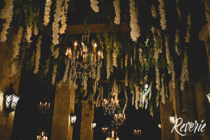 Hanging greenery and orchids at Malibu Rocky Oaks Wedding