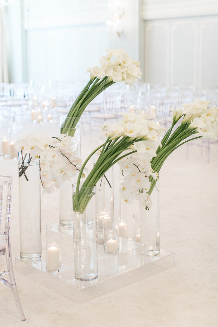 Modern slanted white callas with Orchids at Wedding Ceremony