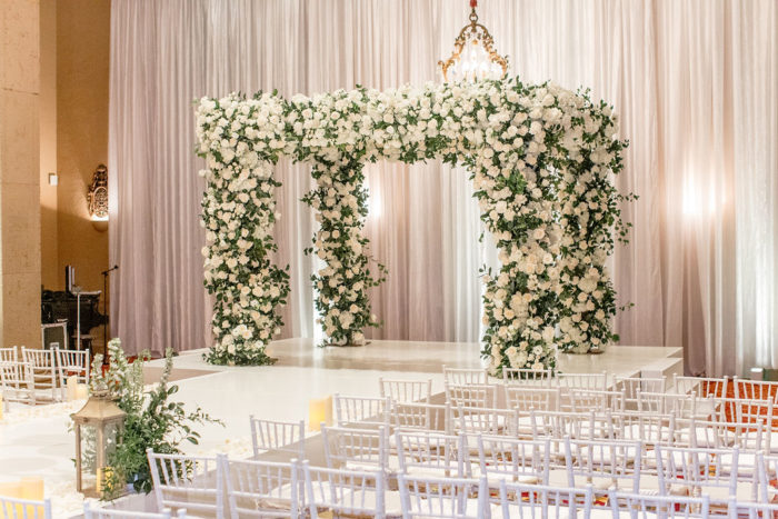 Wedding Chuppah with white roses with greenery