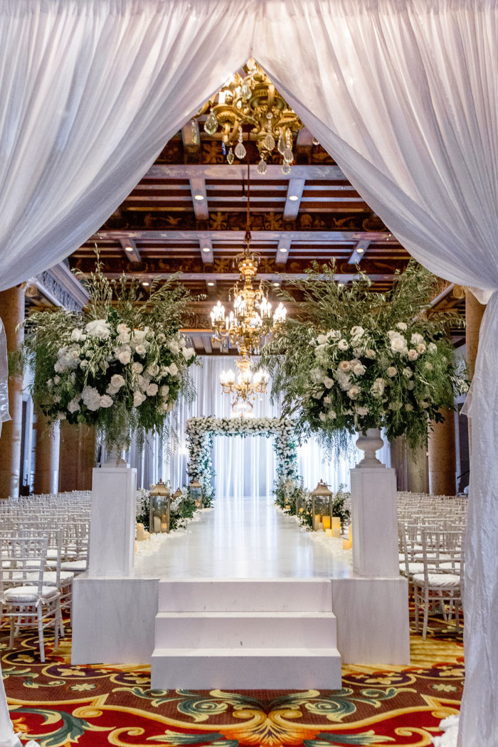 Chuppah with white roses and greenery at Millennium Biltmore