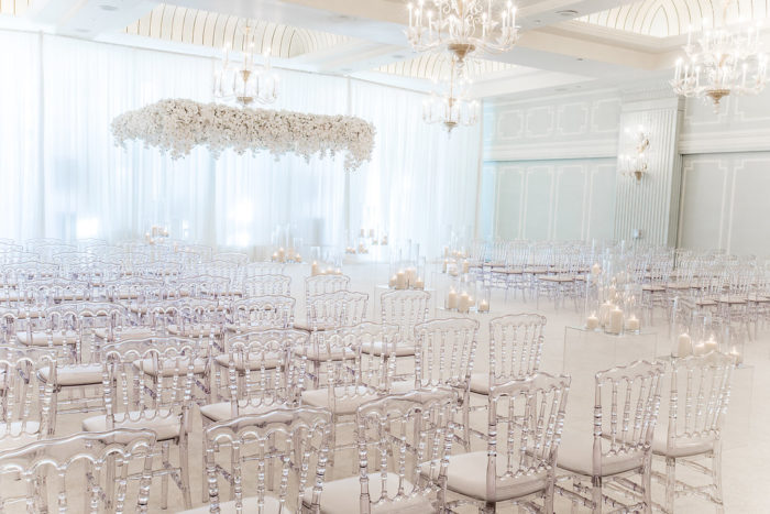 Clear Louis Chairs at White Wedding Ceremony