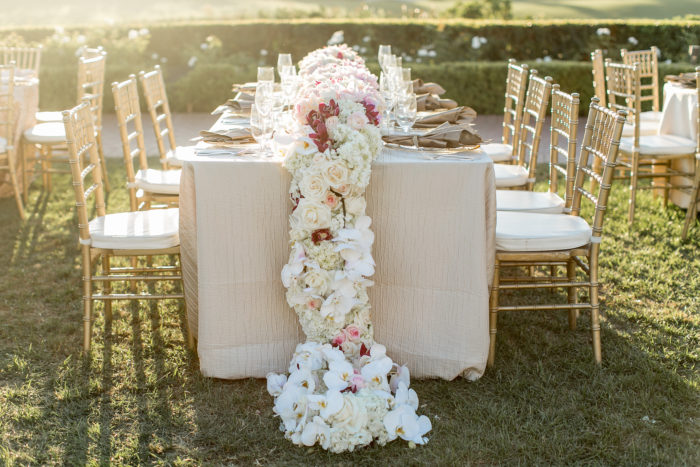Wedding floral table runner with white orchids and hydrangeas