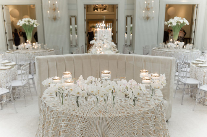 Wedding sweetheart table with ivory gray and gold linen