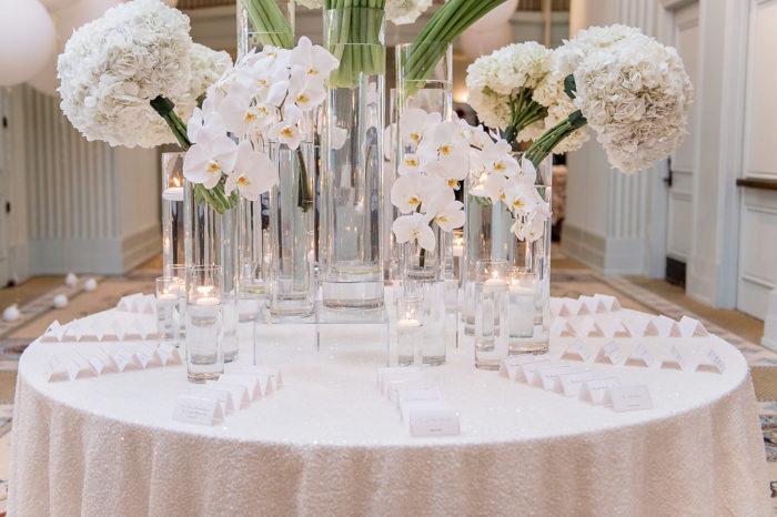 Modern White Flowers on Wedding Escort Table
