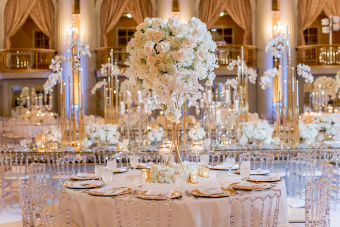 Tall wedding centerpiece with white orchids hydrangea and roses