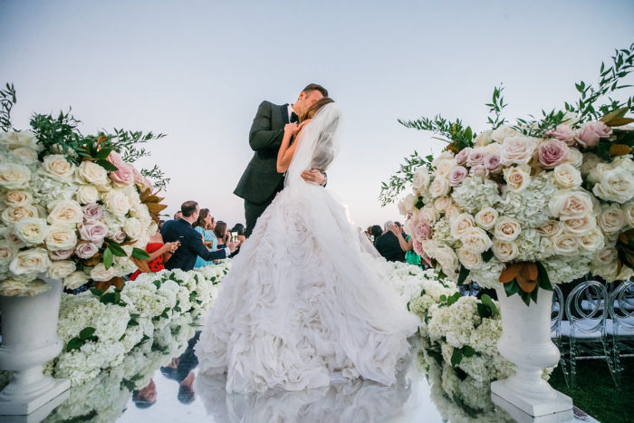 Bride and room kiss on catwalk