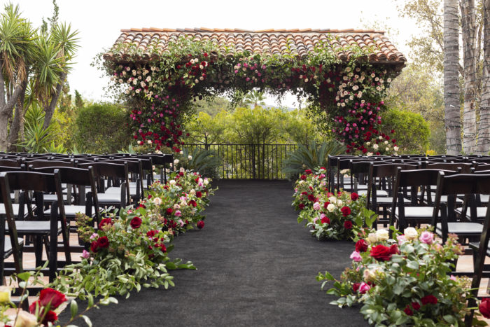 Ceremony Hummingbird Nest Ranch with Red and pink flowers and greenery
