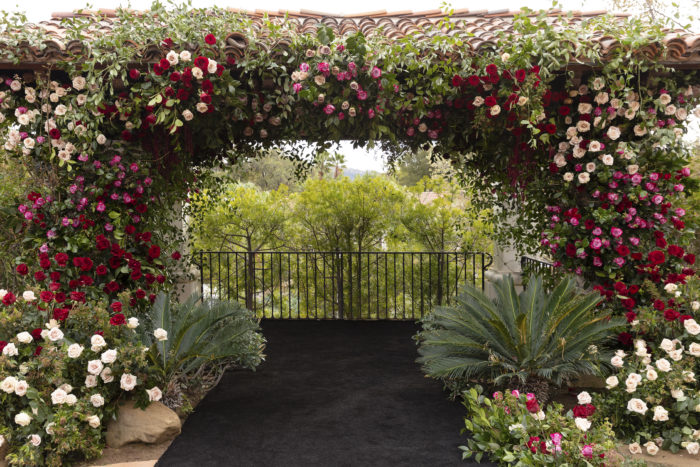 Large chuppah on arch at Hummingbird Nest Ranch with flowers and greenery