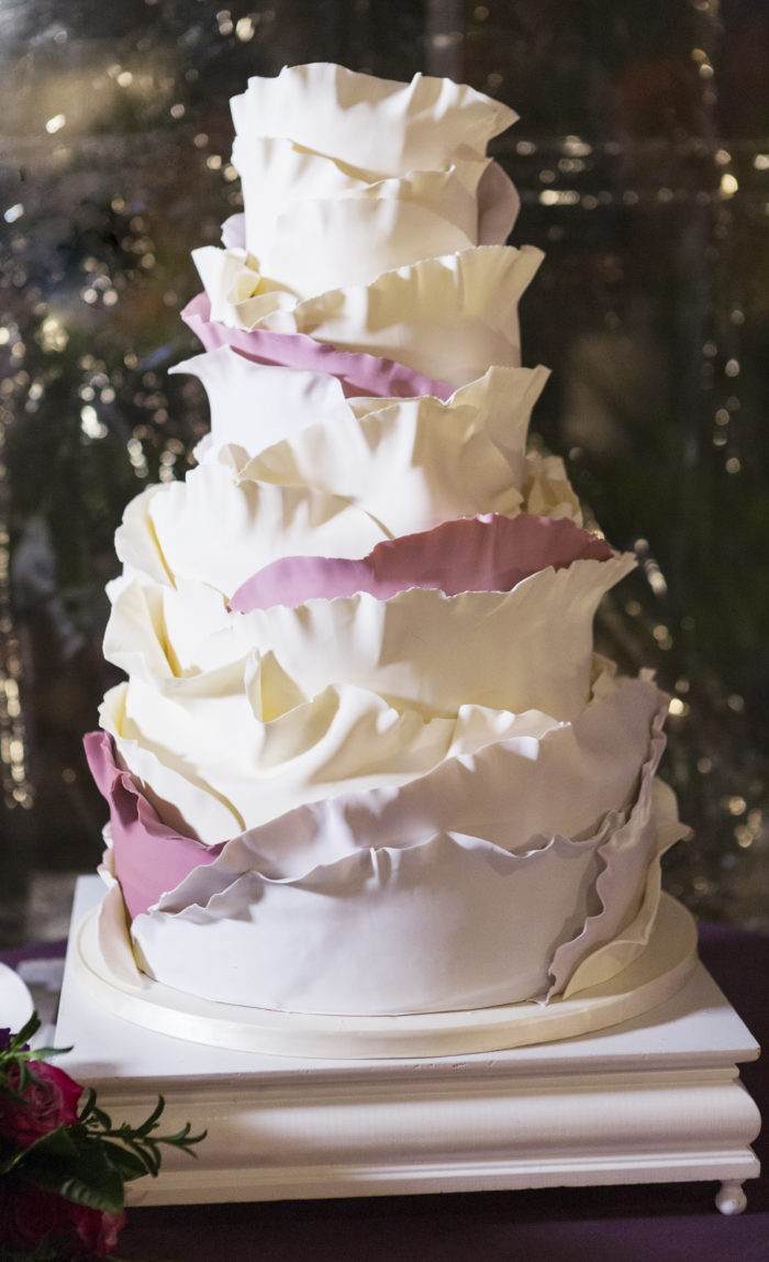 Butter End wedding cake with ruffled fondant layers