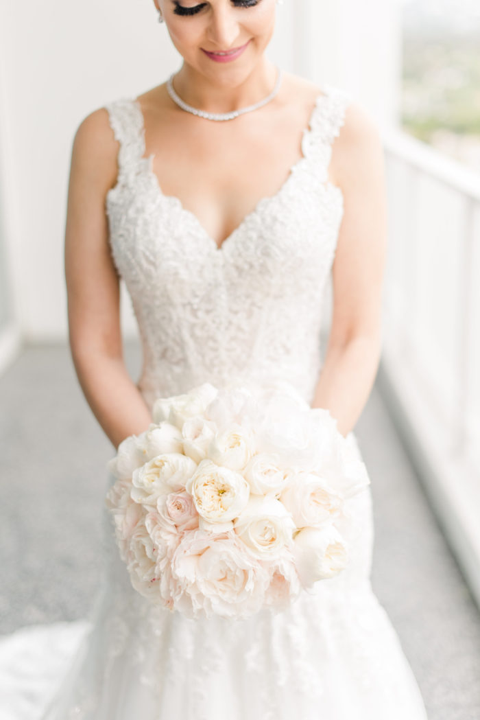 Bride with blush peony and rose bouquet