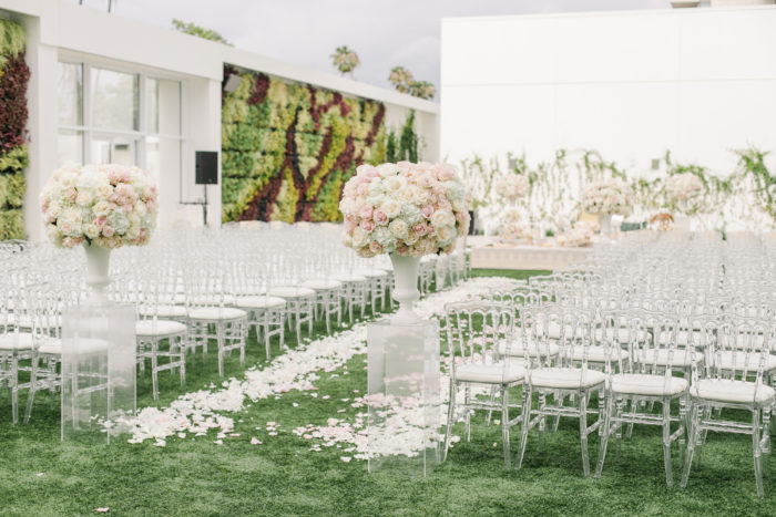 Ceremony aisle at Beverly Hilton with Urns of Roses and hydrangeas