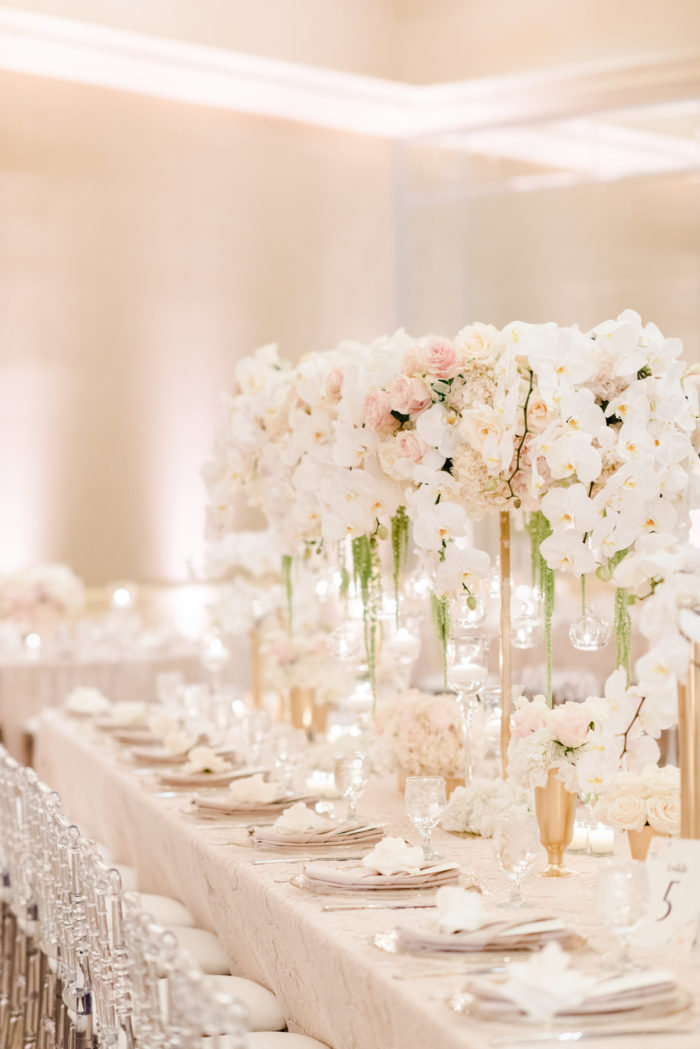 Bridge centerpiece at Neutral wedding with orchids and roses