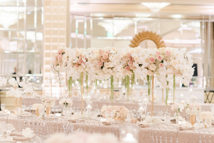 Bridge centerpieces at neutral wedding with green amaranthus pink roses and white orchids
