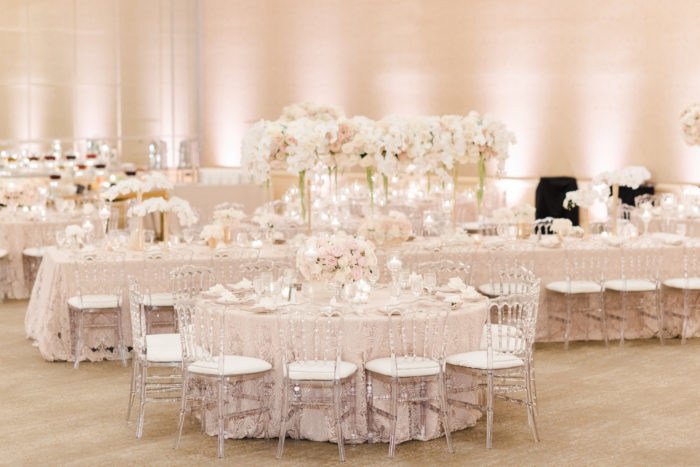 Clear louis IV chairs with pale pink tablecloth at Beverly Hotel wedding
