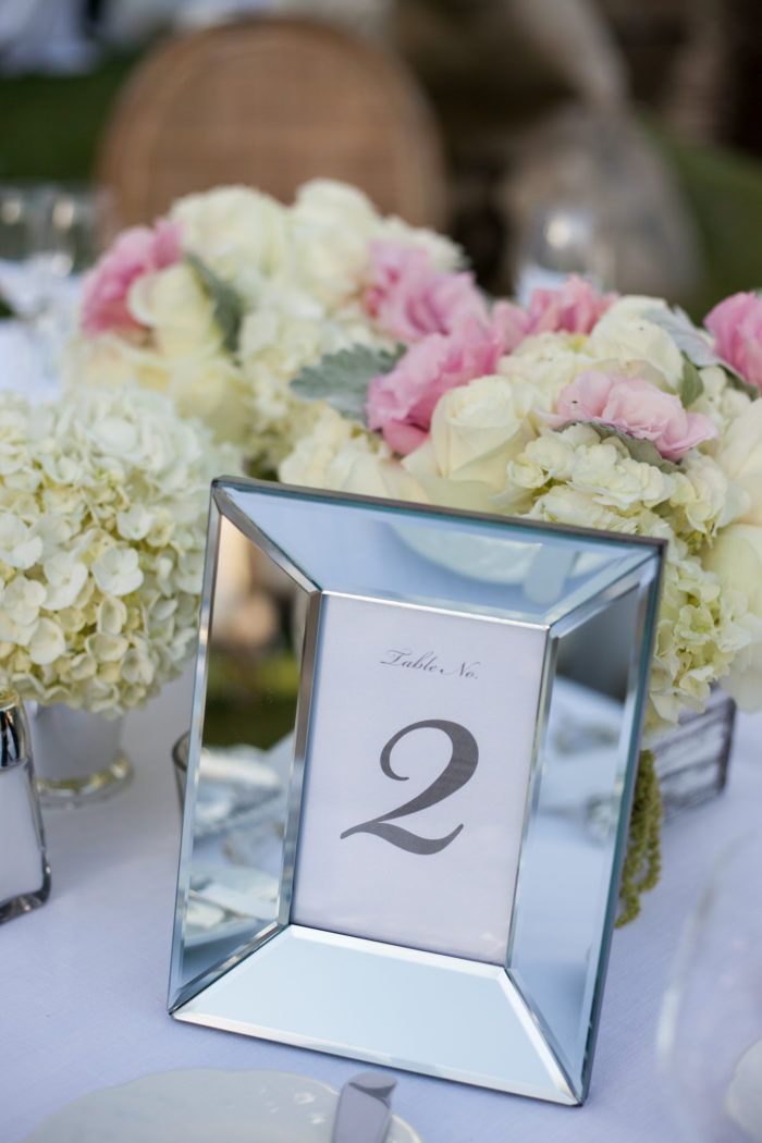 Mirror frame table numbers at wedding reception at Four Seasons Westlake