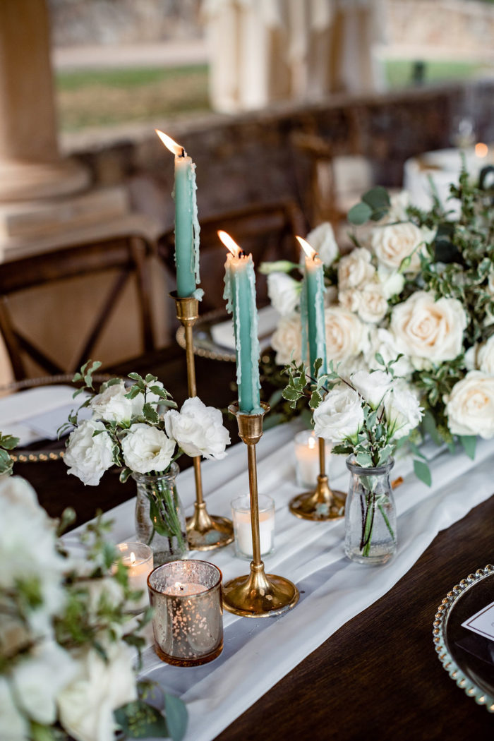 Green taper candles and chiffon runner at rustic wedding in Ojai