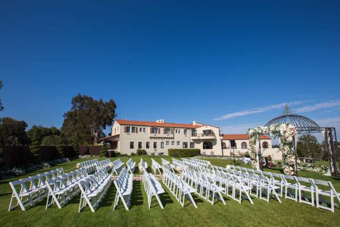 Riviera Country Club ceremony setup with white chairs