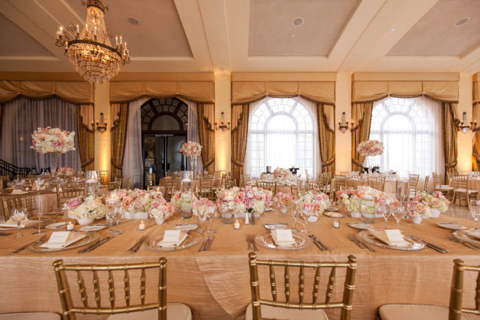 Wedding reception setup in blush and gold at Riviera Country Club
