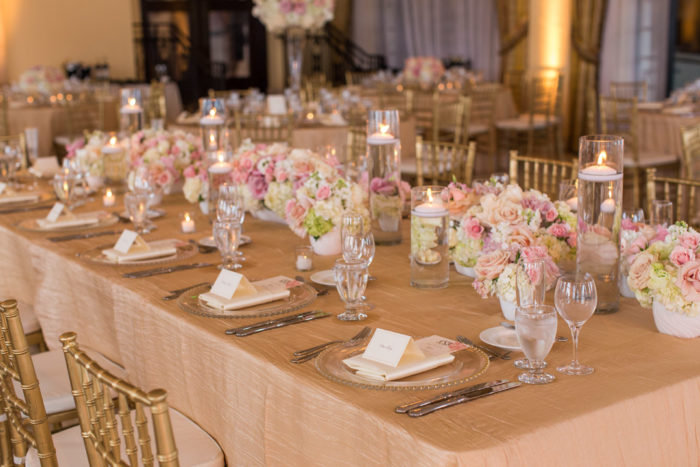 Wedding reception setup with blush linens at Riviera Country Club