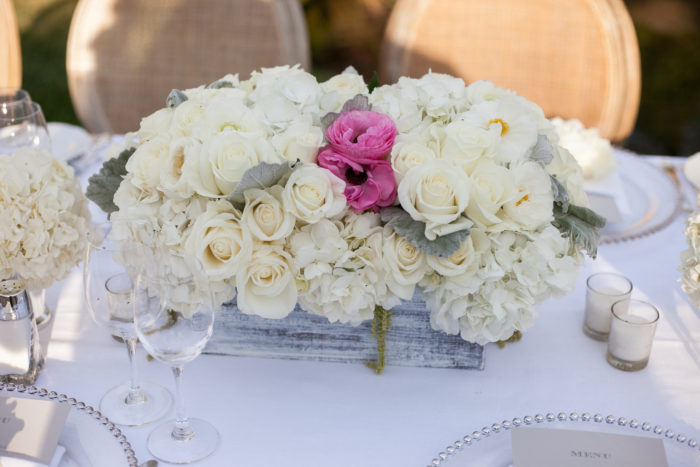 Wood box with florals for wedding reception centerpiece