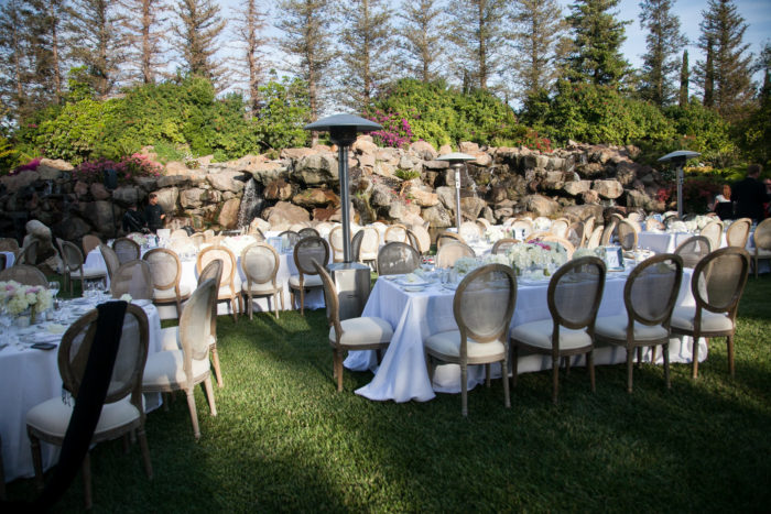 Rustic Round Back chairs at Wedding Reception