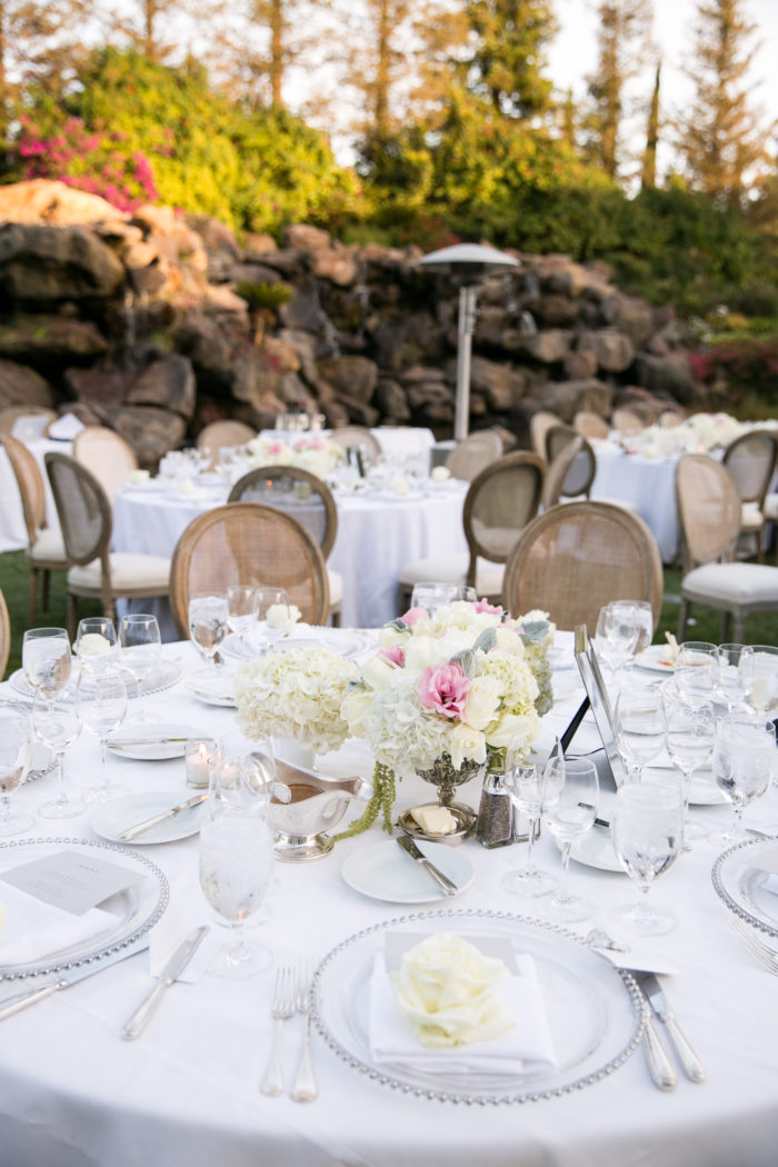 Compote centerpieces with pink and ivory roses at Four Seasons Westlake Village