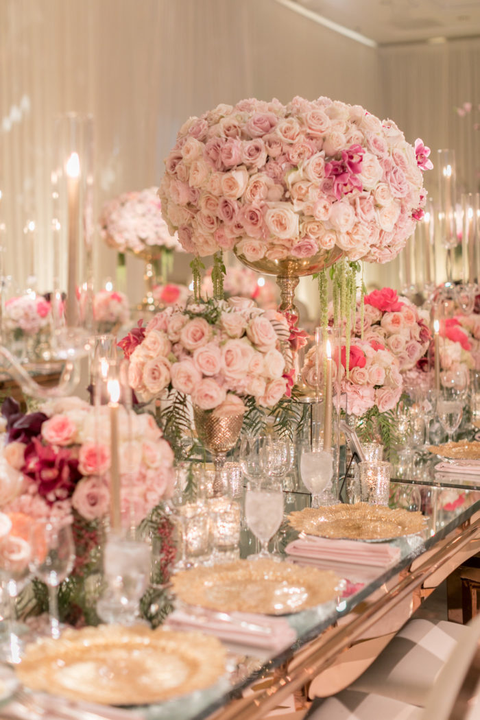 large tall centerpiece with pink roses and pink orchids and gold stand