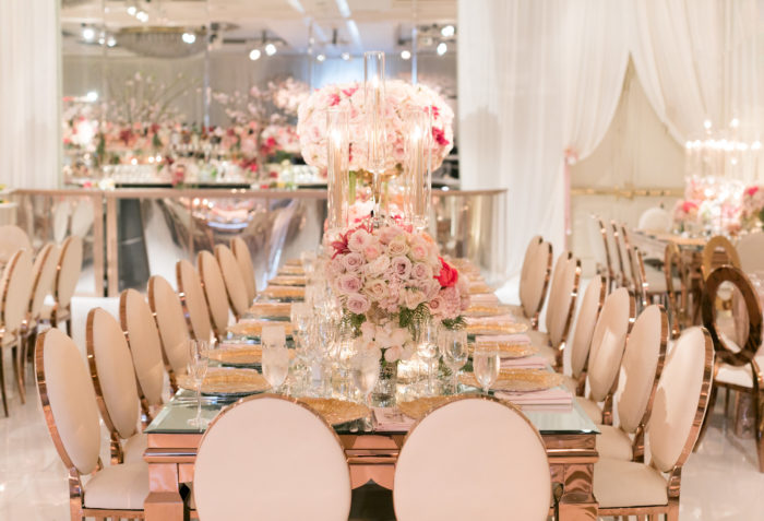 white rental chairs and rose gold tables  with blush pink floral centerpieces
