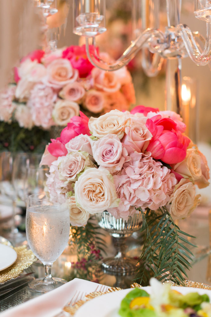 Pink roses pink hydrangea and pink peonies in mercury compote with pepper tree greenery
