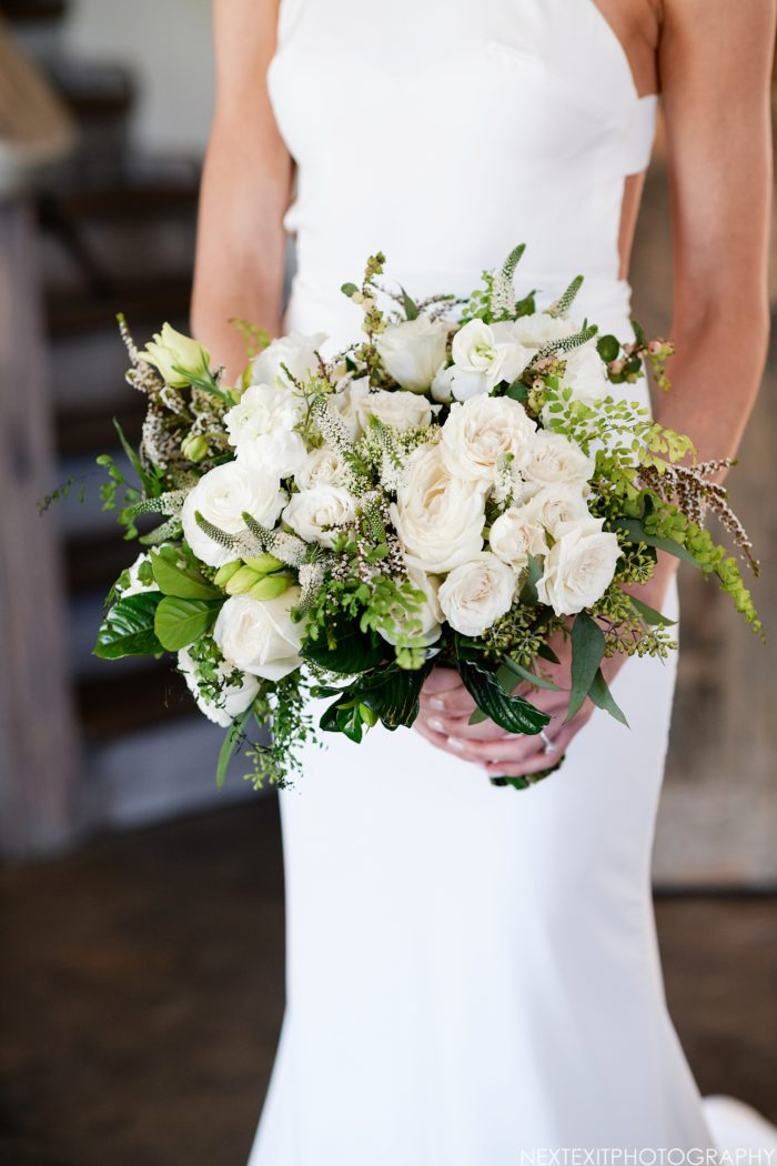 Rustic ivory bridal bouquet with veronica, roses, and greenery