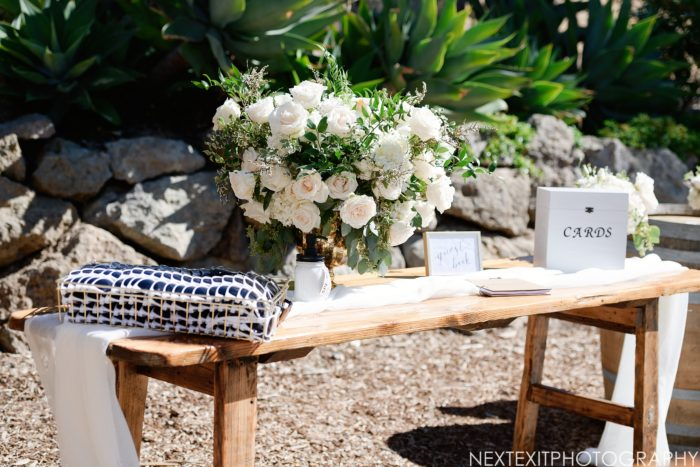 Card table with rustic ivory and greenery wedding centerpiece